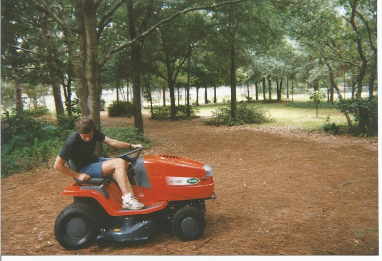 A man and his mower, even had a cup holder