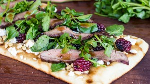 Grilled Pizza with Flank Steak, Blackberries and Watercress (photo courtesy B&W Quality Growers)