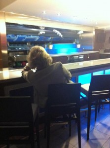 This woman looks comfy but lonely - NOT your typical hotel bar!