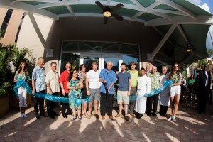 Harris Rosen is joined by Staff and VIP's while cutting the ribbon at the Aug 19 Grand Opening of Harry's Poolside Bar and Grill, Rosen Centre Hotel, Orlando.