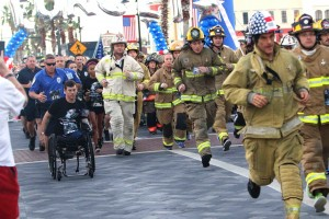 Mike racing alongside Orlando's first responders at the 2017 T2T race held at Crane's Roost, Altamonte Springs. Many rescue squads run in full gear.