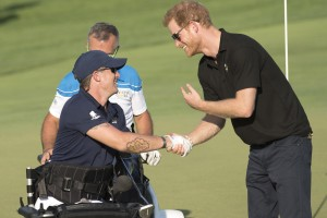 Yep, that's Prince Harry, founder of the Invictus Games, shaking hands with Mike after watching him shoot an amazing 150 yard swing on the golf course during the 2017 Invictus competitions.