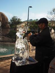 Hard to believe these guys have to wear a jacket while creating a poolside masterpiece but after all, it is ICE! Only in Florida!