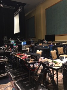 Backstage may look like a mess but thankfully the AV techs know every chord, plug, and outlet to make it all sync.