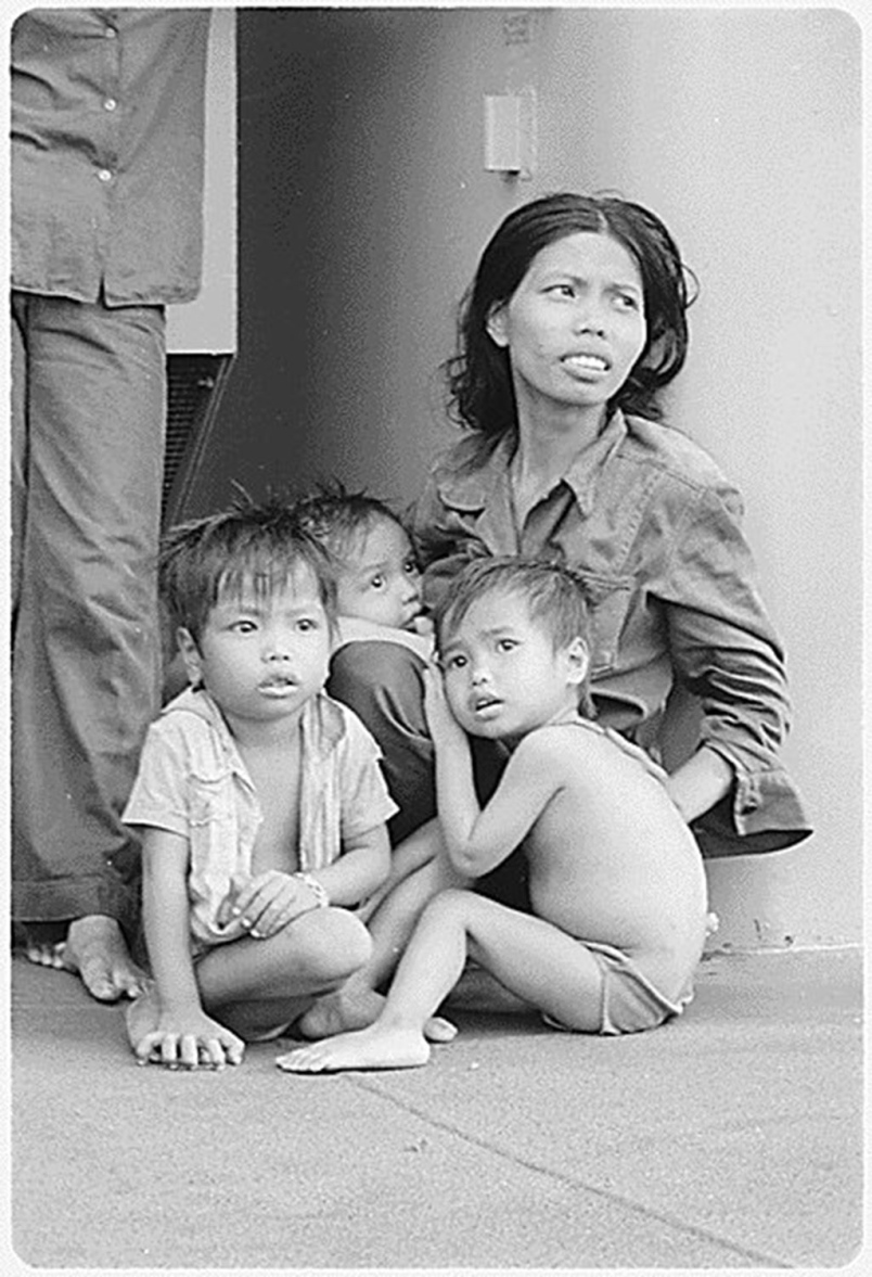 Doan's mother with Doan, Kim, and Phong. Photo courtesy of U.S. Naval Archives