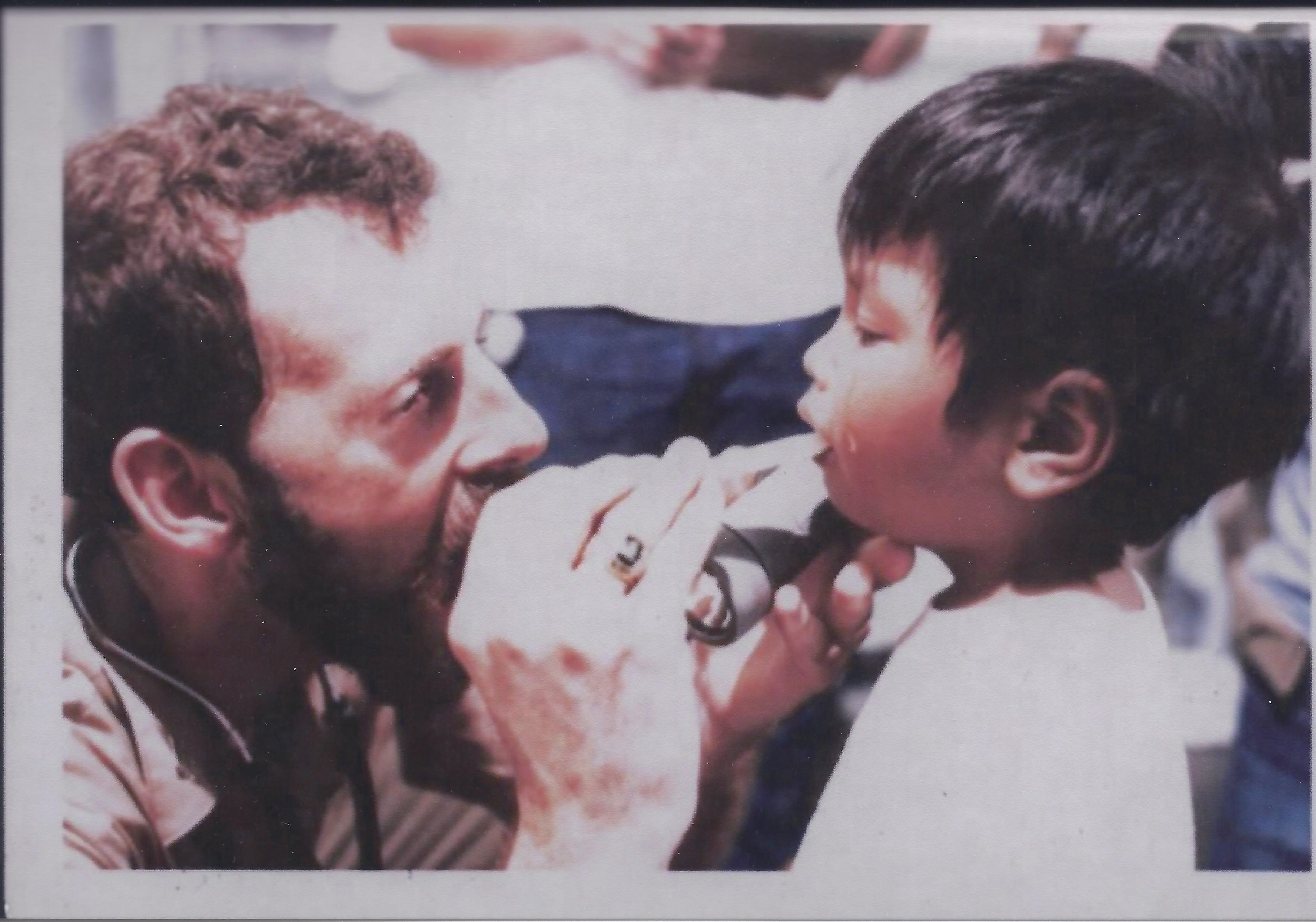 Me examining a 5 year old Doan Ha on the Wabash in 1979. Photo courtesy of U.S. Naval archives