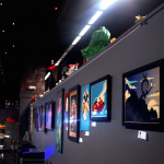 The walls are covered with art for sale.