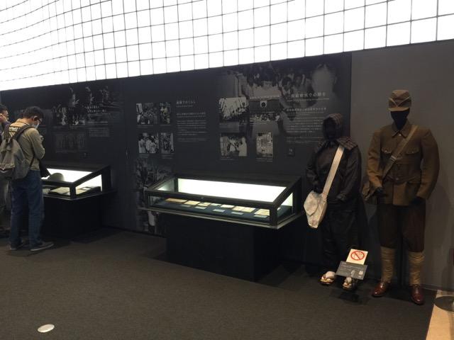 Osaka International Peace Center men and women dressed for war.